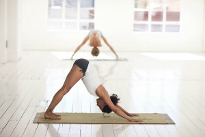 woman doing downward dog yoga pose