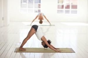woman doing downward dog yoga pose