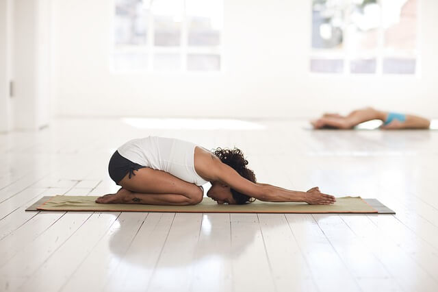 woman doing resting yoga pose