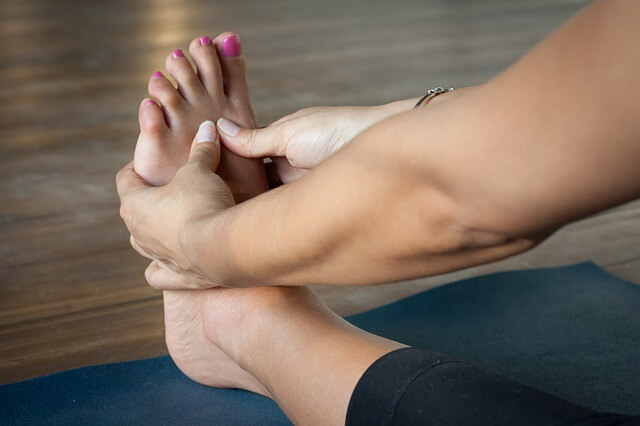 woman stretching in a yoga class