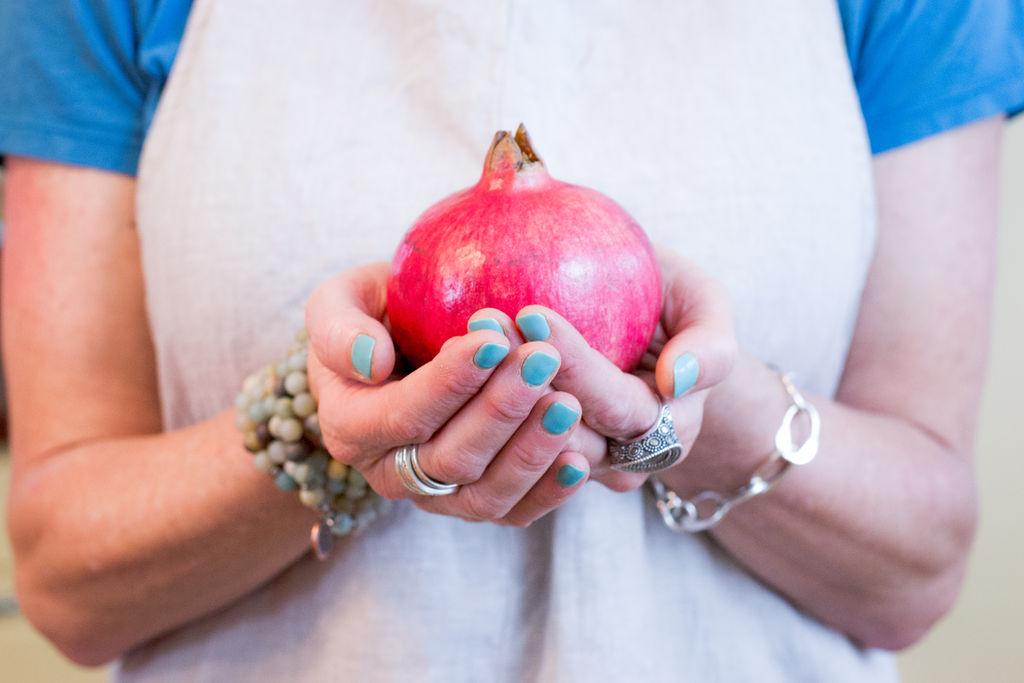 holding pomogranate