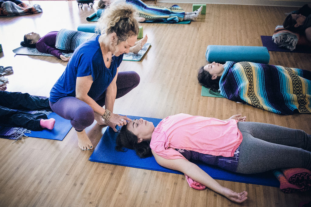 Jenny with student in Yoga class